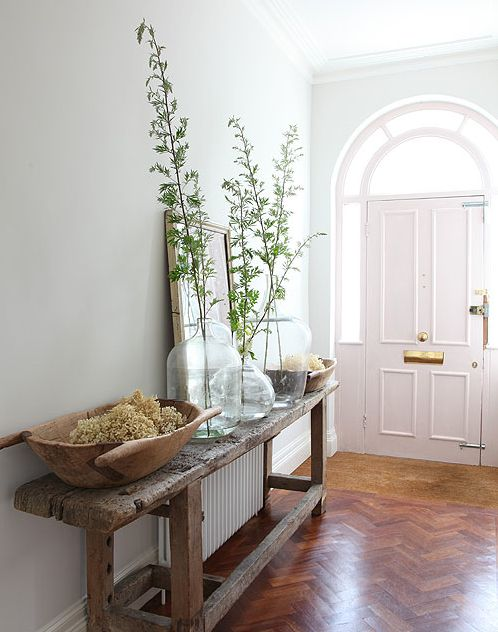 Entryway table. Don't be afraid to mix the rustic with new. Creates a stunning contract!