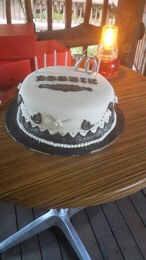 Cake.  Black, white & silver. 70th birthday.