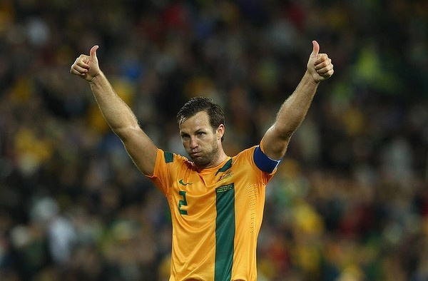 Australian captain Lucas Neil acknowledges the fans after Australia drew with Japan 1 all. FIFA World Cup Asian Qualifier match between the Australian Socceroos and Japan at Suncorp Stadium on 12 June 2012.