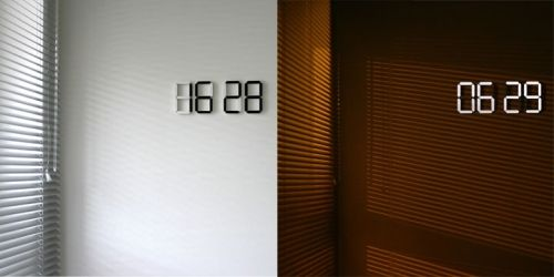 black white clock Digital and Automated Organic LED Wall Clock. sleek, and very cool looking. Want it.