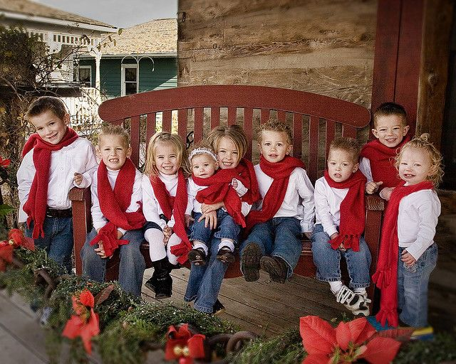 Christmas. Great idea for family photo...red scarves, white shirts, and blue jeans.