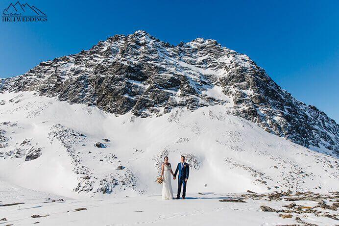 wedding photos of bride and groom in Snowy spring wedding. Destination Heli weddings Queenstown.