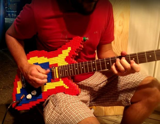 Now You Can Rock Out With Your Block Out Using This LEGO Guitar. Helloooo Legoland, are you ready to rock?! Youtuber, guitarist, and LEGO enthusiast Nicola Pavan put together this fully functional LEGO guitar. Here's a video of him playing it. It is pretty impressive. All he's missing is some minifig groupies hanging out backstage. Hey, maybe there are some minifig groupies back there.