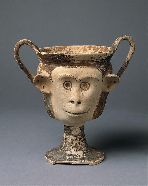 Cypriot terracotta kantharos in ahspe of monkey head, archaic period,  mid-6th century B.C. 14.6 cm high. Metropolitan museum of art
