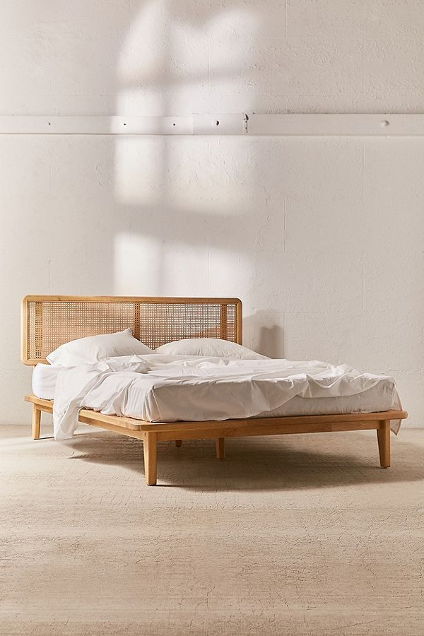 This Rattan Decor Line Is So Popular That Urban Outfitters Can T Keep It Stocked Platform Bed Designs Bed Frame With Storage Bed Design King bed frame for sale