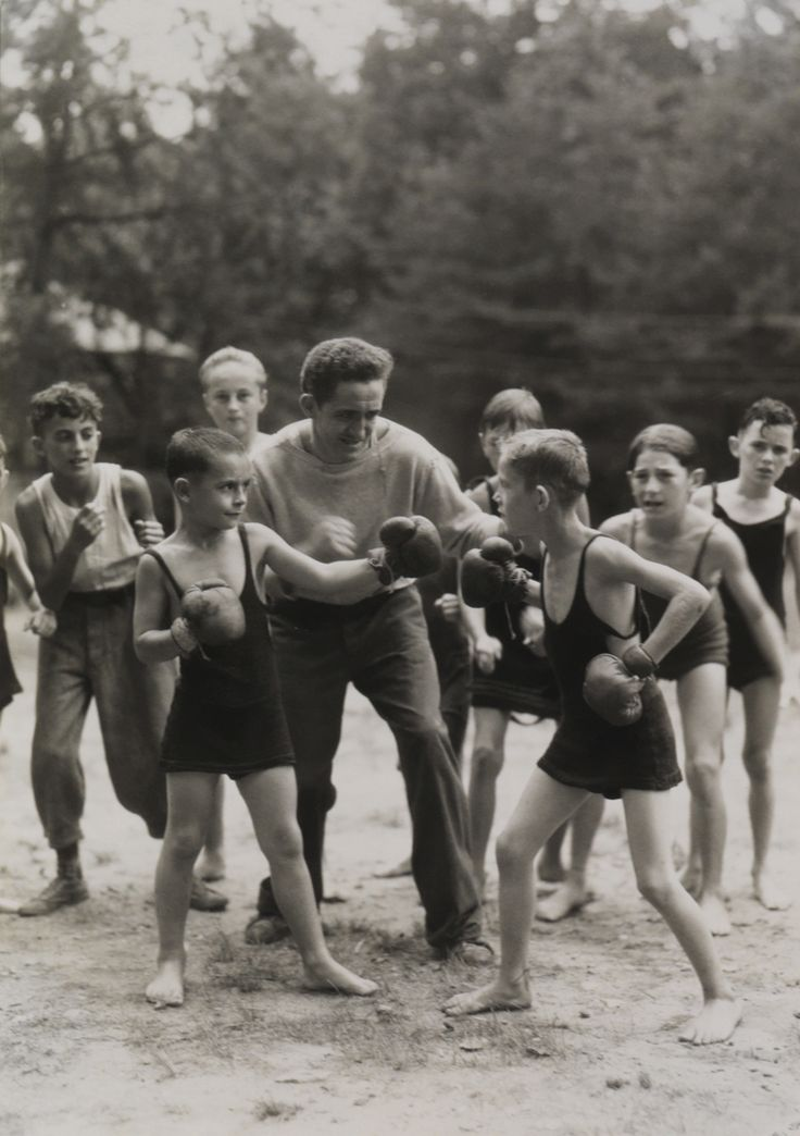 Boys boxing in Washington D.C.  Photograph by Orren R. Louden, National Geographic