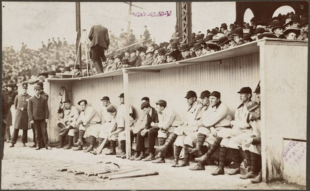 "BASEBALL, 1903 World Series: The Pittsburgh Pirates in the dugout at the Huntington Avenue Grounds, 1903 World Series versus the Boston Americans. The Boston team was named the ""Red Sox"" in 1908."