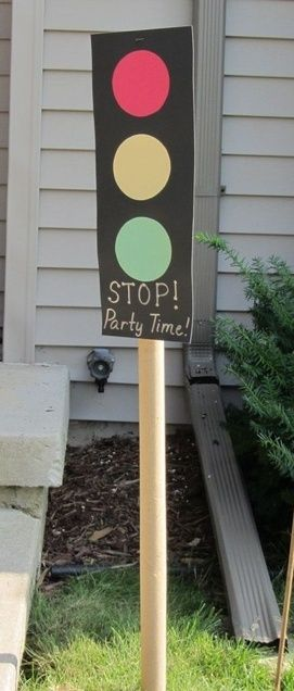 """Cars"" Party Decor – ""STOP! Party Time!"" Stoplight made of construction paper, stapled onto a wrapping paper tube. 