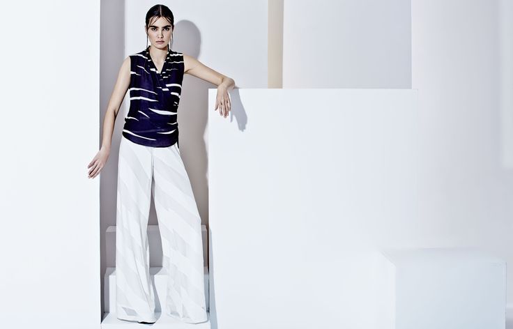 Elegant semi trasparent pants and abstract printed blouse, futuristic style