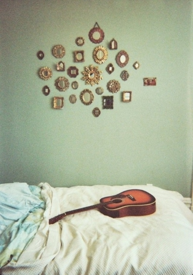 Love this! Except I'm going to do picture frames of all sizes in bright colors for a hipster/boho feel.