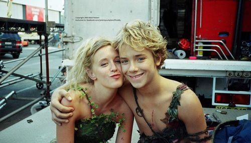 """A dress that appears to be made of leaves and vines...naturally perfect for her. Tinkerbell and Peter Pan from the 2003 """"Peter Pan"""" movie."""
