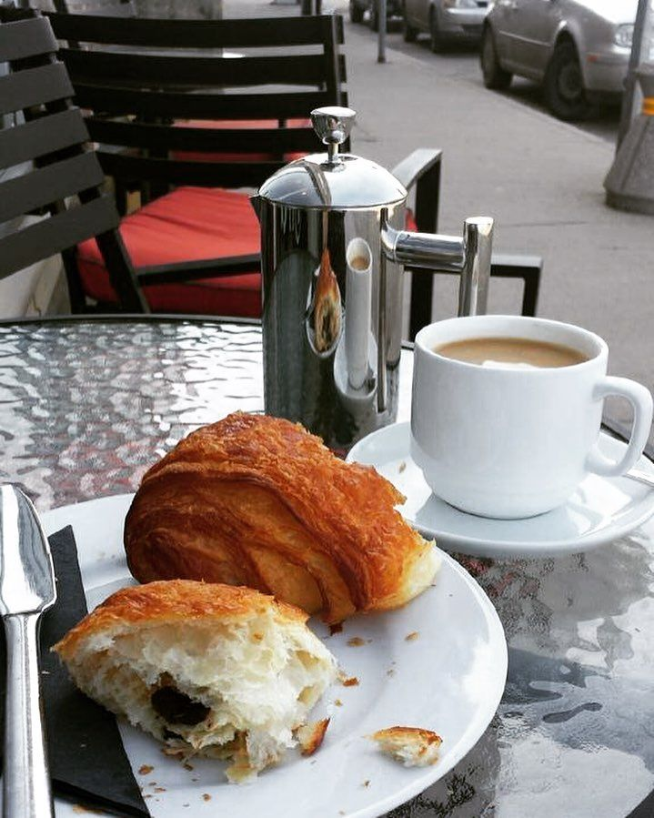 French Press and Pain au Chocolat on the sidewalk.