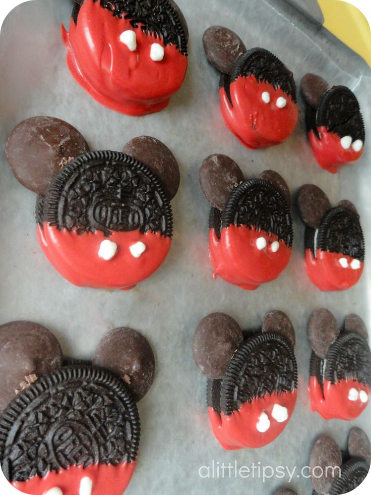 Mickey Oreos. I would use mini Oreos (pulled apart, creme removed) for the ears and candy pearls for the buttons.