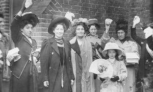 Emmeline Pankhurst, the English suffragette celebrating with Christabel Pankhurst and others after b