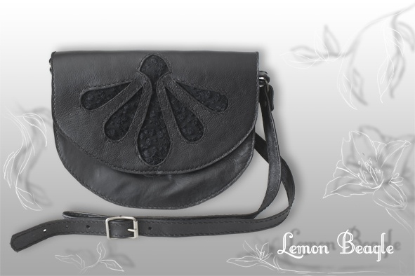 This bag is called Melantha. For more info go to http://www.facebook.com/LemonBeagle