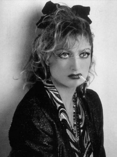 Joan Crawford...long before Madonna used this look in the 80's.