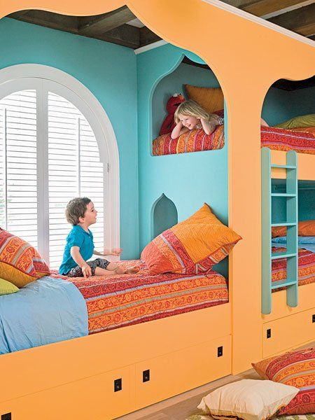 This Morrocan-inspired room from  Babyology is a great example of how built-ins can transform a room. The cheerily-painted custom bed-for-three also includes a fun overlook window.  Photo Source: Babyology