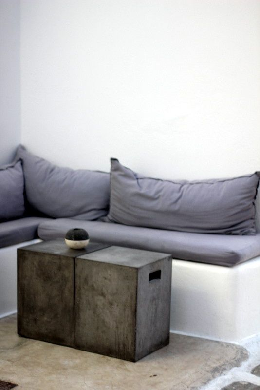 = grey bench seat and concrete tables