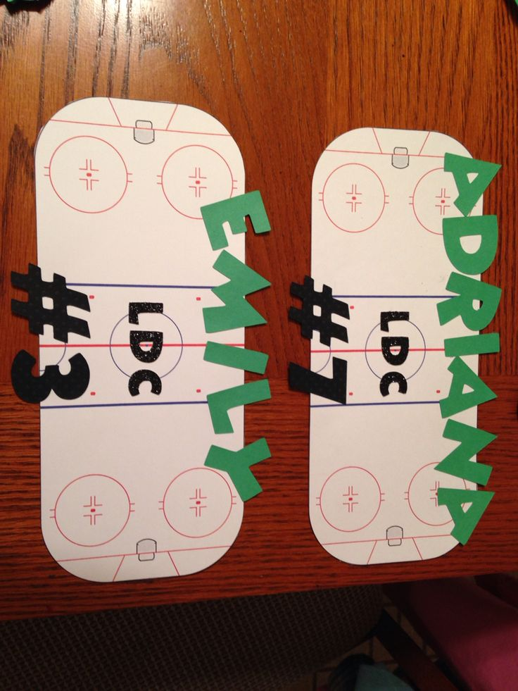 Easy hotel door decors for hockey tournament. Printed out an ice rink from free images on card stock, cut out names, etc on crickut & glued them on!