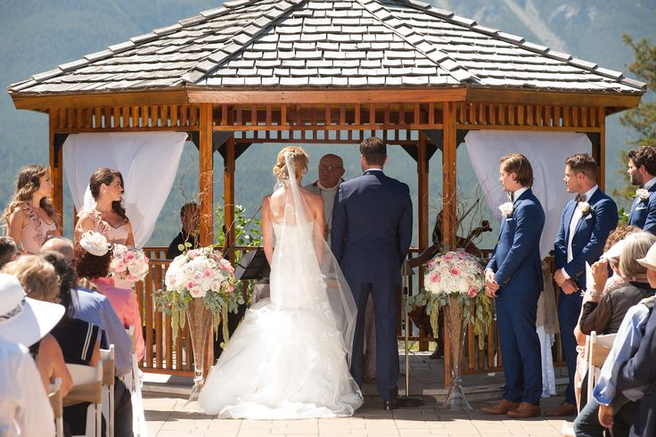 August wedding at Silvertip Resort in Canmore, Alberta with elevated floral designs of hydrangea, roses and hanging amaranthus.  Flowers by Janie- Calgary Wedding Florist www.flowersbyjanie.com  Photo: www.cristalee.com