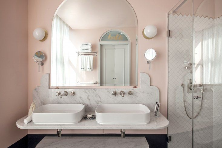 Pink guest bath with scalloped marble, Henrietta Hotel, London, Dorothée Melichzon design. Karol Balas photo.