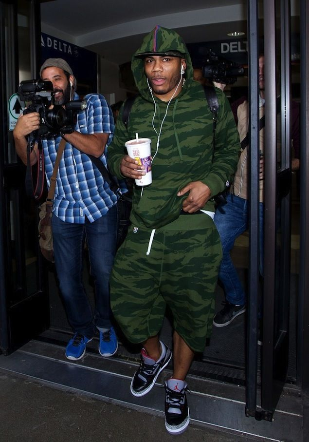 Nelly wearing Undefeated Camo Pullover Hoodie and Shorts