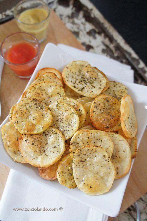 Chips di patate al forno   tagliarle con la mandolina. prima forno ventilato 10min. poi grill . poi rigirarle