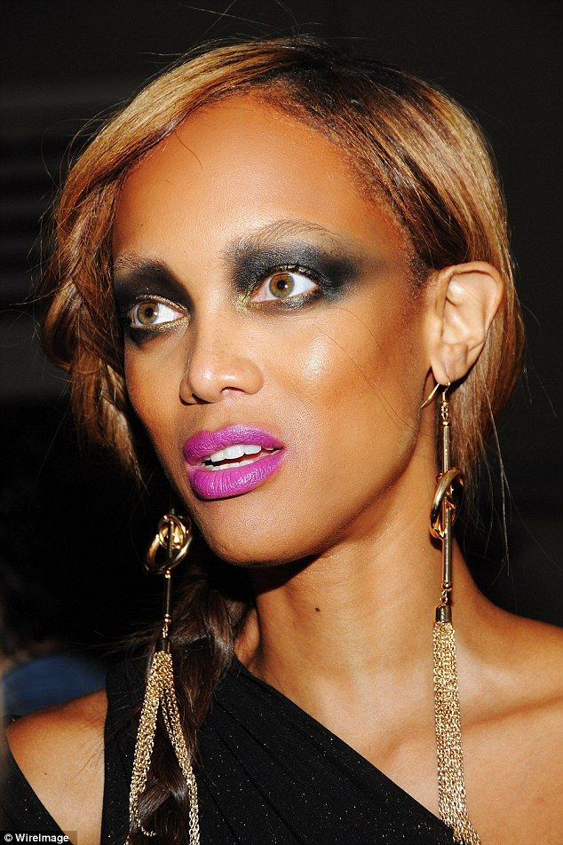 It's not Halloween! Tyra Banks looked like she had done her make-up in the dark with her thick black eyeshadow and neon pink lips at a ball in New York City in 2012
