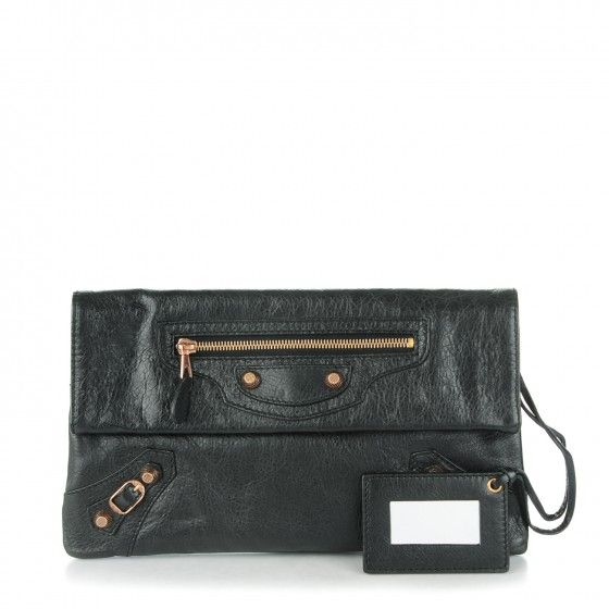 BALENCIAGA Agneau Giant 12 Rose Gold Envelope Clutch in Black. This stylish clutch is crafted of supple agneau lambskin leather and features oversized rose gold buckles with belts and textured studs, a facing zipper pocket and a fold over top.