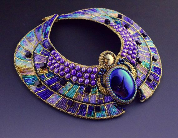 Feminine high fashion collar necklace in angelic color palette of violet, lavender, turquoise, blue, and gold. There is so much light, depth, and movement that camera can not capture.  Inspired by ancient Egyptian mythology and art, it combines Art Deco style geometrical shapes with ancient mythological scarab motif, resulting in a decadent, opulent, mosaic like jewelry treat.