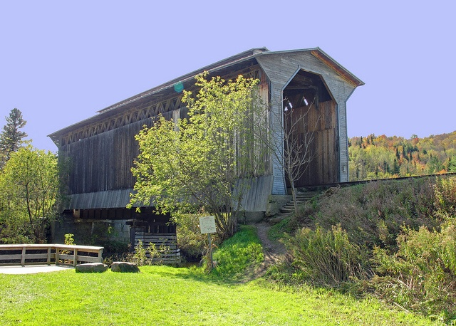 Fisher Covered Railroad Bridge #4  Fisher Railroad Bridge, Wolcott Vermont. Built in 1908, this was Vermont's last remaining covered railroad bridge.