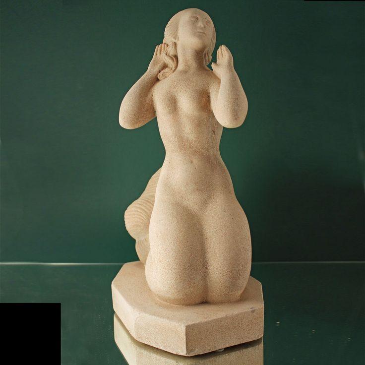 Sandstone sculpture depicting mermaid made by Just Andersen, Denmark. During World War II Just Andersen produced sculptures made of sandstone due to scarcety of metal.