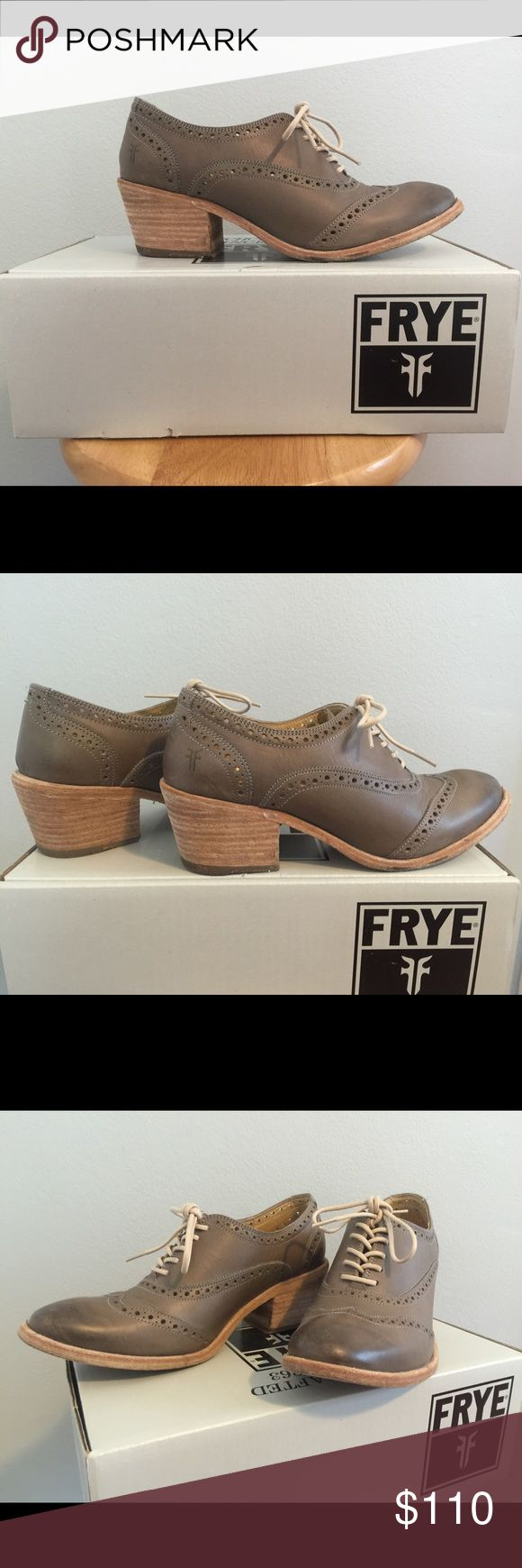 FRYE Maggie Perforated Wingtip Oxfords size 9 Beautiful pair of FRYE wingtip oxfords with a slightly higher heel- super cute with jeans or dresses/skirts. Can be worn with or without socks/tights. Gently worn less than ten times, good condition with slight scuffing on toeboxes. No longer available from FRYE. Color is a sepia-gray with cream leather laces. Frye Shoes Flats & Loafers