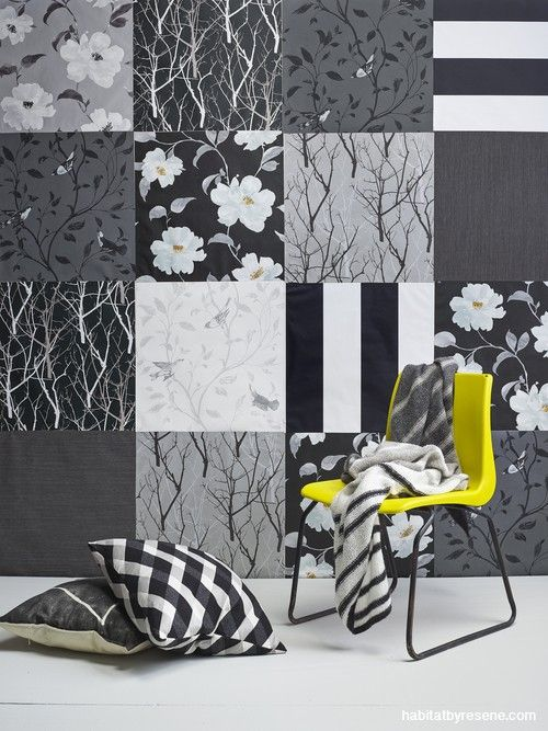 A whole feature wall is papered in a grid of papers using a monochromatic scheme of black, white and silver as the unifying thread.