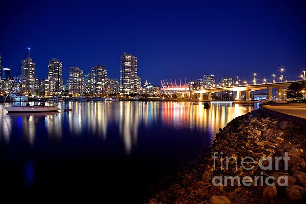 Great time to be at False Creek is just after sunset. Image of the Cambie Street Bridge to the right along with BC Place Stadium, and on the left side is Yaletown and the Yaletown Marina. Vancouver, British Columbia. PHOTOGRAPH TAKEN BY TERRY ELNISKI