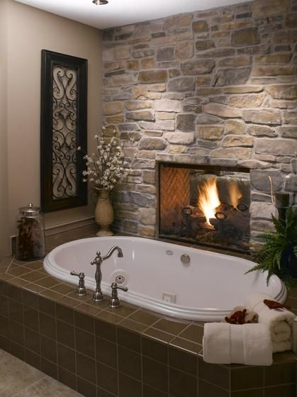 two sided fireplace, one side in the master bedroom and the other side in the bathroom