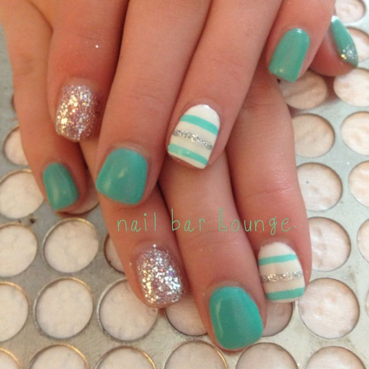 Glitter, striped, and teal nails.