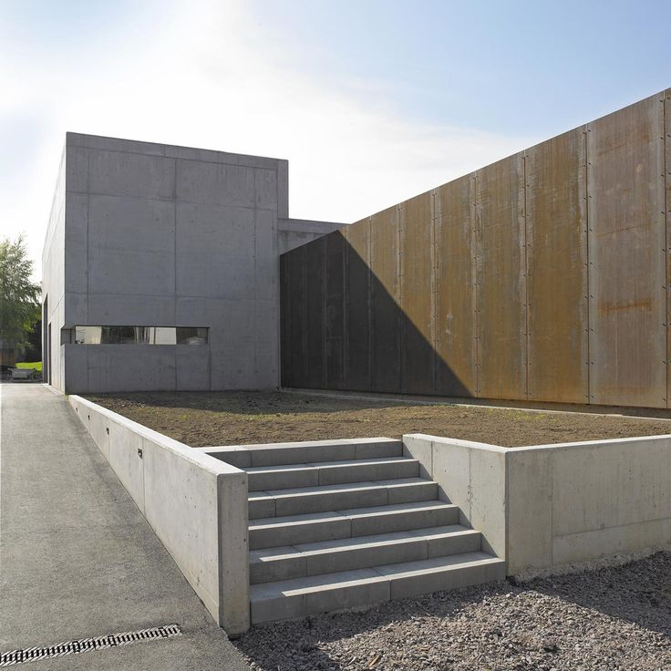 Wine press house for the Bietighöfer winery by Burkhard Architekten in Germany. Weathering corten steel and the purity of the concrete structure were used to reflect the new era of expression of wine artistry for the Bietighöfer winery.