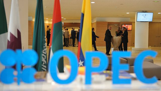 World oil prices slowed the decline on news of OPEC talks