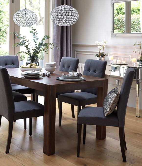 Dining room with dark wood dining table and grey upholstered dining