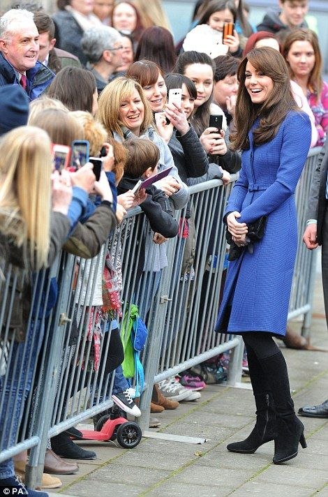 Waiting fans took the opportunity to capture a snap of the royal on their mobile phones: