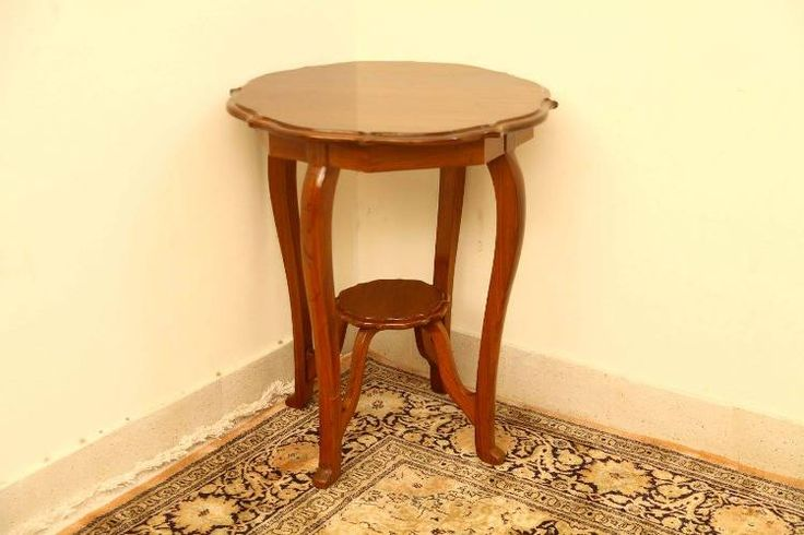BEVERLY TIERED END TABLE - CBF006 In this vintage #roundtable with #QueenAnne legs, don't miss the #carved circumference of the table and a similar contoured shelf below. ~~~~~~~~~~~~ Code CBF006 | Rs 24000 Dimensions: H-29 * Dia-24 Call +91 9600136668 | hello@envission.org Address & Directions: bit.ly/vintage-furniture-chennai