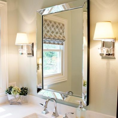 Powder room framless bevelled mirror carrara marble sconces
