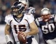 Denver Broncos quarterback Tim Tebow (15) is chased by New England Patriots outside linebacker Rob Ninkovich (50) during the first half of an NFL divisional playoff football game Saturday, Jan. 14, 2012, in Foxborough, Mass. (AP Photo/Elise Amendola)