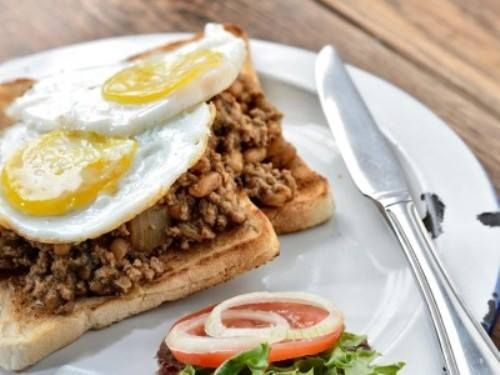 Kick start your morning with a tantalizing Big Bay Breakfast: Toast topped with baked beans curried mince and fried eggs - Cooked to perfection! We're almost ready - are you?