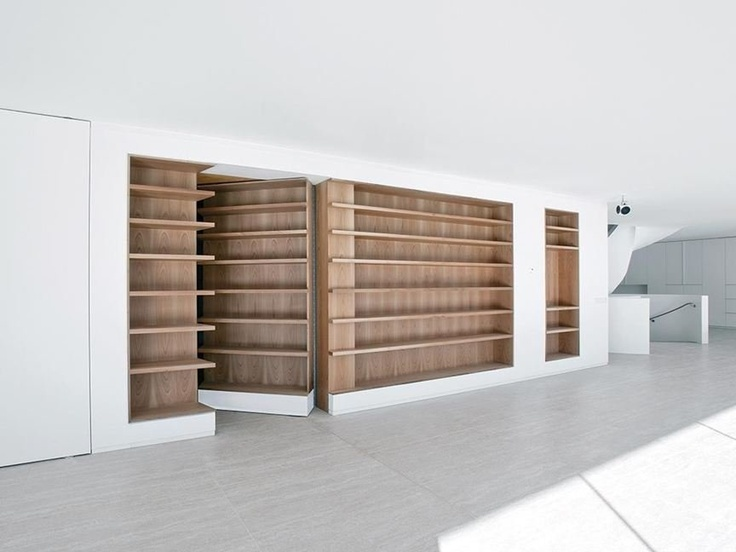 Bookcase passage in Villa   L by Powerhouse Company and Rau. Photo: Christian van der Kooy.