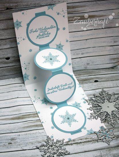 Eine frostige Weihnachtskarte in Babyblau und silb…
