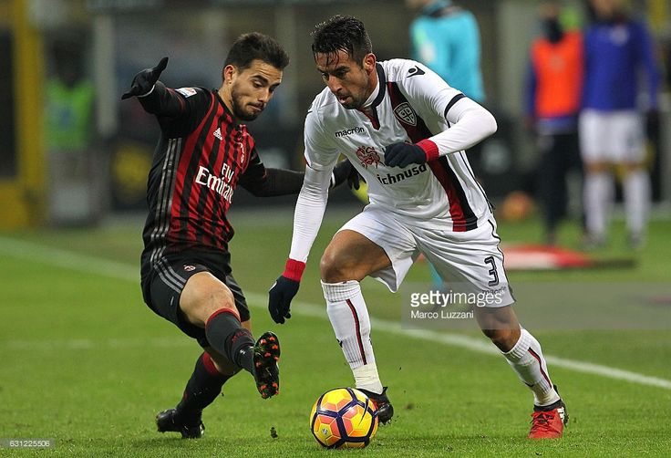 Mauricio Isla (R) of Cagliari Calcio competes for the ball with Suso (L) of AC Milan during the Serie A match between AC Milan and Cagliari Calcio at Stadio Giuseppe Meazza on January 8, 2017 in Milan, Italy.