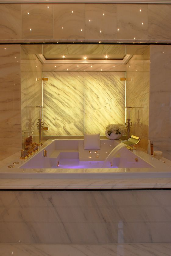 Yes to that bath, throw in glass at the back that looks over the bedroom... and not gold finishing.