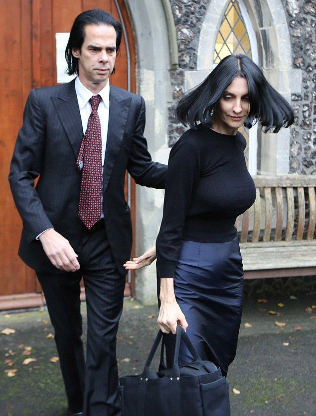 Parents: Nick Cave and Susie Bick leaving the inquest into their son Arthur's death in Bri...
